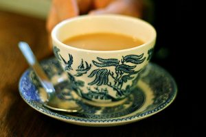 A cup of tea sits in a saucer.