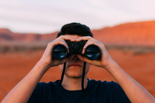 Image of person looking through binoculars by Free-Photos from Pixabay
