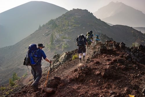 Adventure backpacker climb
