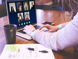 Person video conferencing on a laptop
